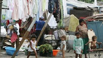 A Gypsy, or Roma family is seen in poor Gypsy settlement, located some 3 kms from downtown Belgrade, Serbia. Thursday, June 14,2007. (AP Photo/Srdjan Ilic)