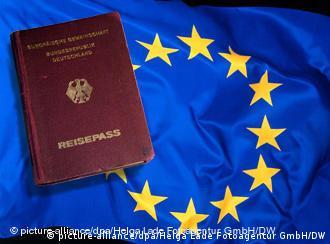 German passport on an EU flag