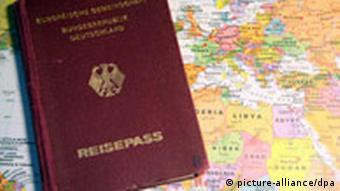 A German passport against a map of the world