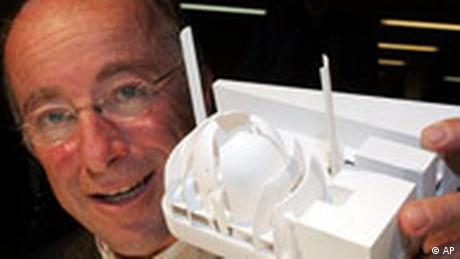 Paul Böhm hods up a model of the mosque (AP)
