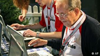Men playing card games on computer