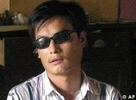 ** FILE ** In this undated file photo released by his supporters, jailed blind activist Chen Guangcheng is seen in a village in China. Chinese authorities on Friday Aug. 24, 2007, barred Chen's wife from leaving the country to accept a humanitarian award on his behalf. Yuan Weijing's passport and telephone were confiscated as she attempted to pass through security at the Beijing airport to fly to the Philippines to attend the Magsaysay Award ceremony.  (AP Photo/Supporters of Chen Guangcheng, File)