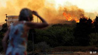 International help began arriving Sunday as Greece tried to cope with wildfires raging out of control on the Peloponnesian peninsula, with the death toll by latest count reaching 53, officials said. A spokesman for the Greek fire department, Nikos Diamantis, said France had sent four fire-fighting planes and Italy two, while France and Cyprus had each sent 60 firefighters to the affected region. On Monday, Greece was expecting four firefighting planes from Serbia and two from Spain, while two helicopters each were to arrive from Germany and the Netherlands. Israel, Romania, Norway and Slovenia were each sending one helicopter, while Switzerland and Iceland have also offered assistance. Slight reprieve The fire department has said efforts to contain the fires had help helped by a drop in the heavy winds that have swept the fires though thousands of hectares of forest and scrub since Friday. We are optimistic that, if the weather and the reduction in the winds hold long enough, we may be able to be more effective, fire department spokesman Nikos Diamandis said, adding that it was impossible to say how large an area had burnt or how many homes had been destroyed. Fires are burning in more than half the country, he said. Early on Sunday, flames were approaching the archeological site of ancient Olympia, birthplace of the Olympic games. Fires have also been reported raging near the port town of Kalamata and near Sparta on the southeastern part of the peninsula and near Corinth in the north. Another fire has been reported on Euboea, Greece's second-largest island. Asking for help Greece had asked for European Union assistance on Friday, in particular water-bombing aircraft, and the European Commission, through its Community Mechanism for Civil Protection, put out urgent calls to the 30 countries that participate in the program. It's a critical situation... much worse than ours, said Italy's public safety chief Guido Bertolaso. Even though we are still in the middle of an emergency in Italy, we cannot be deaf to the Greek government's appeal. The Peloponnese faces a truly catastrophic situation, with a death toll that is continuing to rise incredibly, he said as Italian firefighters continued to battle blazes, notably in Sicily and the Naples region. The death toll from the Greek fires climbed on Saturday as search parties of soldiers and firefighters discovered more charred bodies in cars, homes and the countryside. Call for unity I am saddened by the tragic loss of human lives that these forest fires have brought with them and hope that the European partners will live up to expectations and provide all the material support Greece needs in this moment of distress, said Commission President Jose Manuel Barroso. I am distressed that Europe's Southern shores are once again experiencing climatic conditions that favor the spread of these fires. I am convinced that we need to strengthen our forest firefighting capacity to combat these fires together, added EU Environment and Civil Protection Commissioner Stavros Dimas. It marks the fourth appeal by Greece to its EU partners since June for help in combating forest fires, which have spread due to several heat waves and months of drought. Prime Minister Kostas Karamanlis has blamed arsonists for the inferno and police have so far arrested seven people in connection with the blazes.