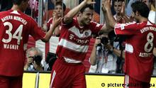 Mark van Bommel, center, celebtrates with teammates Sandro Wagner, left, and Hamit Altintop of FC Bayern Munich after scoring the second goal for his side against Hanover 96 in their German first division Bundesliga soccer match in Munich, southern Germany, Saturday, Aug. 25, 2007. (AP Photo/Diether Endlicher) **NO MOBILE USE UNTIL 2 HOURS AFTER THE MATCH, WEBSITE USERS ARE OBLIGED TO COMPLY WITH DFL-RESTRICTIONS, SEE INTSTRUCTIONS FOR DETAILS**