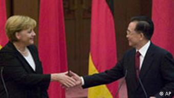 Chinese Premier Wen Jiabao, right, and German Chancellor Angela Merkel shake hands in Beijing