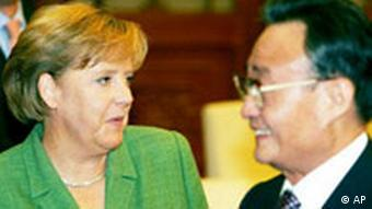 Wu Bangguo, right, the head of China's legislature and the Communist Party's No. 2 ranking official, meets with German Chancellor Angela Merkel