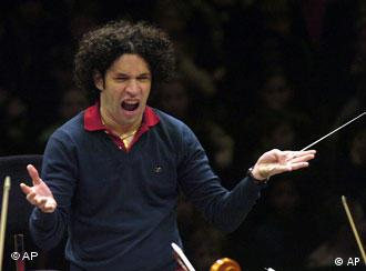 Orchestra conductor gesturing during a rehearsal