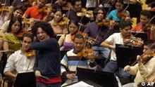 Venezuelan conductor Gustavo Dudamel conducts The Sinfonica de la Juventud Venezolana Simon Bolivar orchestra during a rehearsal at the Culture- and Congress Center in Lucerne, Switzerland, Friday, March 23, 2007. Dudamel and the orchestra will present their Swiss debut while opening the Lucerne Festival on March 24. (AP Photo/Keystone/Sigi Tischler)