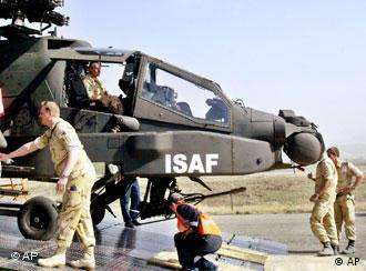 Dutch soldiers unload an Apache-D helicopter from a cargo aircraft in Kabul,