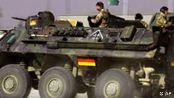 A German armored vehicle, with troops