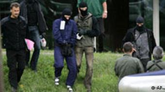 A terror suspect is led away at the German Federal Court in Karlsruhe on Sept. 5, 2007