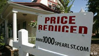 A sign to inform prospective buyers that the price has been reduced sits on top of the sale sign outside a single-family home in south Denver on Sunday, Sept. 2, 2007. The asking price for the home was listed at $550,000. The U.S. economy will slow sharply this year and fall behind growth rates in most of the world, according to forecasts in a U.N. report released Wednesday, Sept. 5, 2007. Woes in the housing market will drag U.S. gross domestic product for 2007 to a modest 2 percent growth, compared with 3.3 percent last year, the U.N. Conference on Trade and Development said in its flagship annual report. (AP Photo/David Zalubowski)