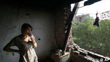A Chechen woman stands at the window of her flat which was ruined during more than a decade of separatist fighting in Chechnya, in Grozny, Russia, Wednesday, Sept. 5, 2007. Regional authorities have undertaken a massive rebuilding effort but many buildings in Chechnya's provincial capital still bear the scars of war. (AP Photo/Musa Sadulayev)