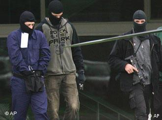 A possible terror suspect, left, is lead away at the German Federal Court in Karlsruhe, southern Germany, Sept.5, 2007.
