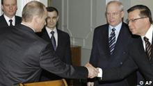 Russian President Vladimir Putin, left, shakes hands with Viktor Zubkov, Head of the Federal Financial Monitoring Service, at a Security Council meeting in the Novo-Ogaryovo residence outside Moscow, in this March 11, 2006 file photo. President Vladimir Putin nominated Viktor Zubkov who oversees the fight against money laundering to become the new prime minister, in a surprise move that will stoke speculation as to who Putin might tap to succeed him after next year's presidential elections. From left background are Federal Security Service Director Nikolai Patrushev, Russian Interior Minister Rashid Nurgaliyev, Head of Russia's Foreign Intelligence Service Sergei Lebedev. (AP Photo/RIA-Novosti, Sergei Zhukov, Presidential Press Service) ** NO SALES NO ARCHIVES EDITORIAL USE ONLY NOT FOR USE AFTER OCT 12 2007 **