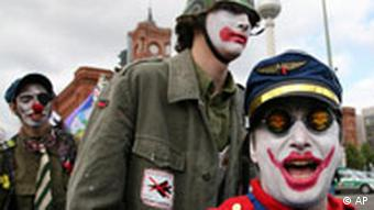 Protestors dressed like mock soldiers are pictured during a demonstration against the German government's Afghanistan policy