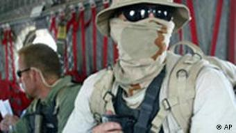 US private security officer with his face covered against dust