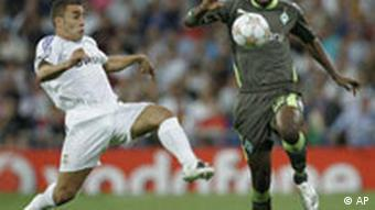 Real Madrid's Fabio Cannavaro,, left, duels for the ball against Werder Bremen's Boubacar Sanogo