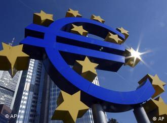 A euro coin and notes