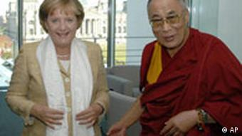 Merkel with a white scarf that she received from the Dalai Lama