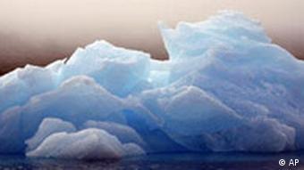 An iceberg floats in a bay off Ammassalik Island, Greenland