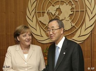 German Chancellor Angela Merkel, left, shakes hands with United Nations Secretary-General Ban Ki-moon at UN headquarters