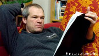 Uwe Boll reading a script