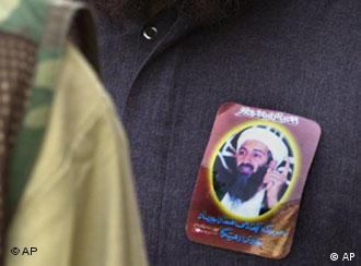 A man wearing a sticker showing his support for terrorist Osama bin Laden, attends an anti-US rally