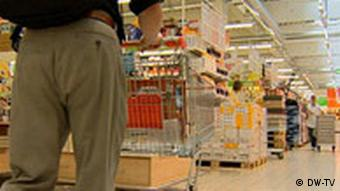 A man shops in a supermarket