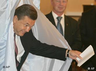 Viktor Yanukovych emerges from a voting booth in 2007.