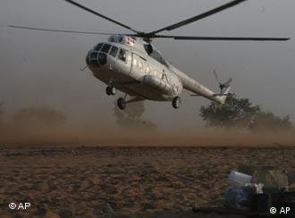 A helicopter landing in Sudan's troubled Darfur region