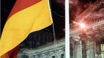 The German flag is hoisted by school children from East and West in front of the Reichstag building in Berlin Tuesday Oct. 3, 1990, in a ceremony marking the unification of Germany.