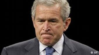 George W. Bush with his lips pressed tight together