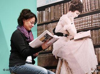A woman reads a book at the Book Fair in Frankfurt