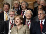 Angela Merkel (medio) en el Simposio sobre Sustentabilidad Global.