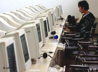 A Chinese man uses the computer at an internet cafe in Beijing Friday, Oct. 5, 2007. Reporters Without Borders, an international media rights group called on China on Wednesday to loosen controls on Internet news and personal expression, calling the country's system of censorship an insult to the spirit of online freedom. (AP Photo/Ng Han Guan)