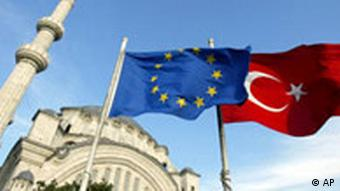 Flags of Turkey, right, and the European Union are seen in front of a mosque in Istanbul