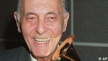 FILE-- Sir Georg Solti smiles after receiving his 30th Grammy Award from Mike Greene, president of the National Academy of Recording Arts and Sciences at the Rainbow Room in New York April 30, 1992. The world renowned conductor who led the Chicago Symphony Orchestra to fame, died Friday, Sept. 5, 1997. He was 84. (AP Photo/ Malcolm Clarke, File)