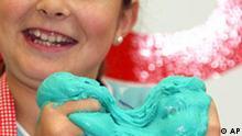 Marie Claire knetet am Freitag, 12. Okt. 2007, in Koeln Essknete der Firma 123 Naehrmittel, die sie wie eine Backmischung mit Wasser angeruehrt hat und die sowohl roh als auch gebacken gegessen werden kann. Essknete gehoert zu den Innovationen der Lebensmittelmesse Anuga. bei der 6.607 Anbieter aus 95 Laendern vom 13. bis 17. Okt. 2007 ihre Produkte praesentieren. (AP Photo/Hermann J. Knippertz) --- Marie Claire poses with the kneadable mass Essknete of German 123 Naehrmittel company during a photo call the the food fair Anuga (Oct. 13 until 17, 2007) in Cologne, Germany, Friday, Oct. 12, 2007. Essknete is a unique innovation for kids. It is prepared by mixing with water like dough. The result is a kneadeble mass similar to conventional play dough. The dough is edible both in its raw state and baked. (AP Photo/Hermann J. Knippertz)