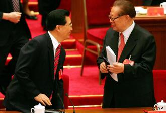 Chinese Communist Party leader Hu Jintao, left, chats with former President and Communist Party leader Jiang Zemin after Hu's speech at the opening of the 17th Communist Party Congress in Beijing's Great Hall of the People Monday, Oct. 15, 2007. Hu opened the congress, held once every five years, by promising modest political reforms while insisting one-party rule will not be weakened. (AP Photo/Greg Baker)