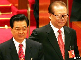 Chinese President Hu Jintao at left and former President Jiang Zemin arrive for the opening ceremony of the 17th Communist Party Congress held at the Great Hall of the People in Beijing Monday, Oct. 15, 2007. The congress, held once every five years, is a crucial test of strength for president and party leader Hu, who is expected to open the meeting with a speech laying out the policy agenda for what is expected to be his final five years in power. (AP Photo/Greg Baker)