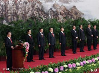 Chinese President Hu Jintao, left, delivers his speech and introduces the new members of the Politburo Standing Committee, from left, Public Security Minister Zhou Yongkang, Liaoning Party Secretary Li Keqiang, head of Communist Party Ideology Department Li Changchun, Premier Wen Jiabao, National People's Congress Chairman Wu Bangguo, Chairman of the Chinese People's Political Consultative Conference Jia Qinglin, Shanghai Party Secretary Xi Jinping, and He Guoqiang, the head of the Communist Party Organization Department at the Great Hall of the People in Beijing, China, Monday, Oct. 22, 2007. The Standing Committee, the inner circle of Chinese political power, was paraded in front of assembled media on the first day following the end of the 17th Communist Party Congress. (AP Photo/Andy Wong)