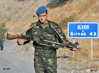 Turkish soldiers patrol on a road in the province of Sirnak, on the Turkish-Iraqi border, southeastern Turkey