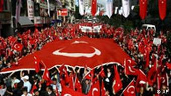 Turkish people wave national flags as they protest against the separatist Kurdish rebel group, the PKK