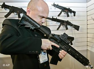 Police officer Piotr Brykalski from Poland looks at the new HK416 enhanced carbine designed by German firm Heckler and Koch at the 14th Paris Milipol 2005, the worldwide exhibition of internal state security, at Le Bourget , north of Paris, Tuesday Nov. 22, 2005. (AP Photo/Francois Mori)