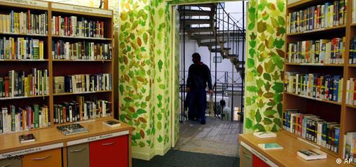 A view of the prison library bookshelves and the painted green vines