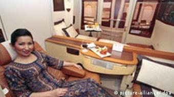 A female passenger in the first class section of a Singapore Airlines jet