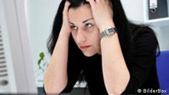 Woman looking stressed out at work