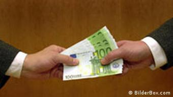 Euro bills being passed from one hand to another