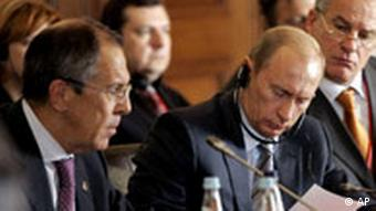 Russia's President Vladimir Putin, center, flanked by Foreign Minister Sergey Lavrov